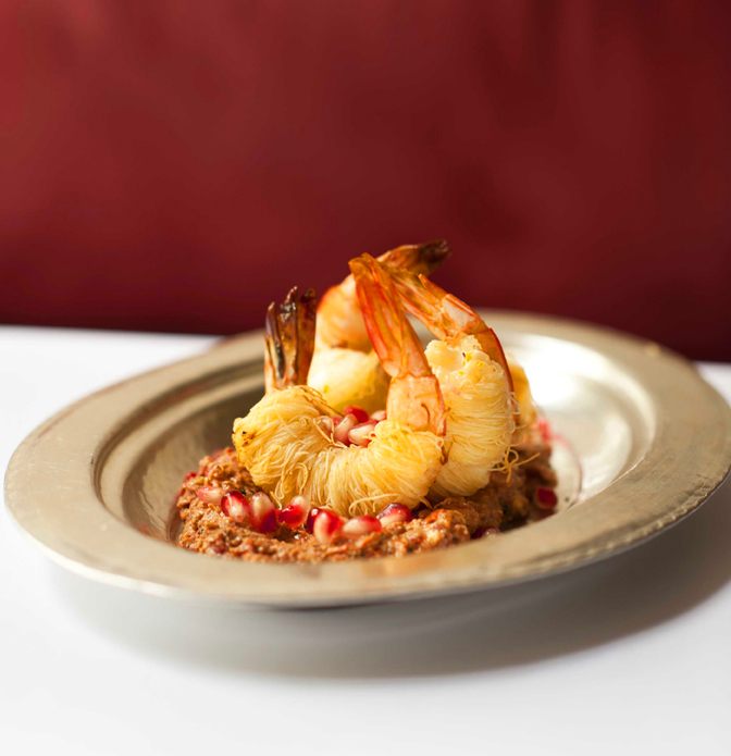 Shredded pastry-wrapped king prawns on Muhammara